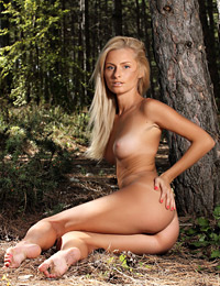 Model alba in sunlight in the forest