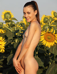 Model marta in flowers in the field